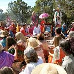 Fire ceremony at Haidakhandi Universal Ashram. Ramloti is standing to the left of the umbrella.