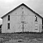 Prelimary plans include restoring the facade of this old sale barn. Photo by Larry Calloway